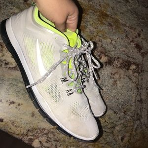 White and neon yellow Nike Free Tru Fit 4